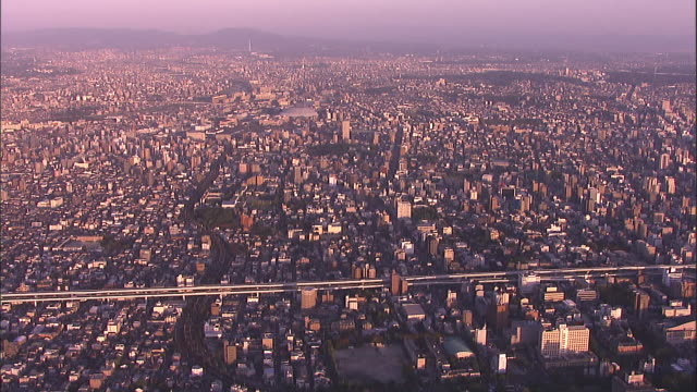 An elevated freeway cuts through the cityscape of Nagoya.