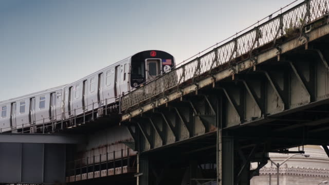 An Elevated Subway (J train) car travels along the tracks in Brooklyn