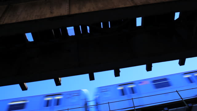 an elevated subway train passes overhead. - elevated train stock videos & royalty-free footage