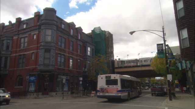 an elevated train crosses over armitage avenue in the wrigleyville neighborhood in chicago. - elevated train stock videos and b-roll footage
