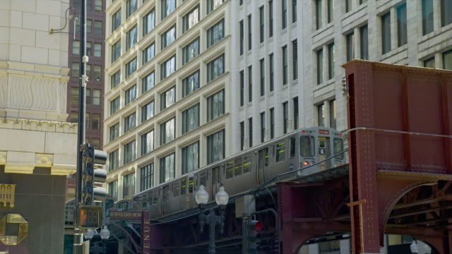 An elevated train speeds past office buildings in Chicago, Illinois.