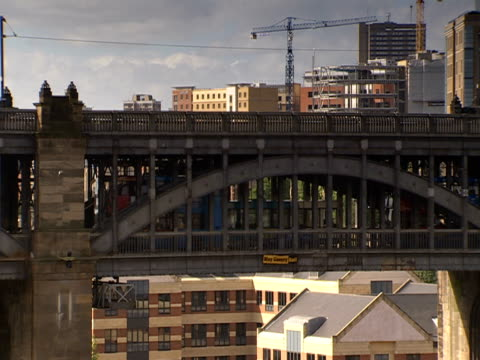 an elevated train travels over an enclosed bridge. - elevated train stock videos & royalty-free footage