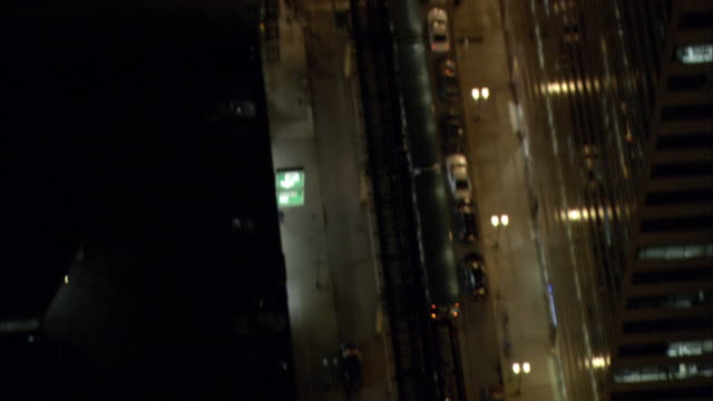 an elevated train travels through downtown chicago at night. - elevated train stock videos & royalty-free footage