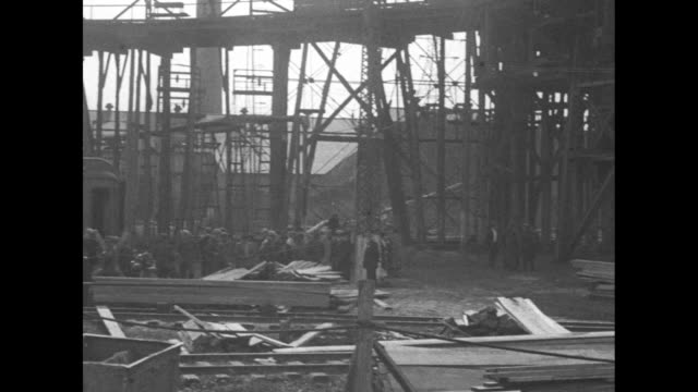 an elevated view and a pan of the heavily industrial pabst iron mine with scores of people waiting for news as rescue attempts continue for 43... - mine shaft stock videos & royalty-free footage