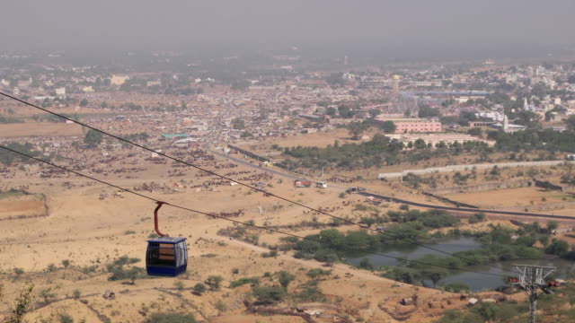 an elevated view from the sarawati temple hell looking down towards the pushkar camel fair and mela grounds in rajasthan, india - rajasthan stock videos and b-roll footage