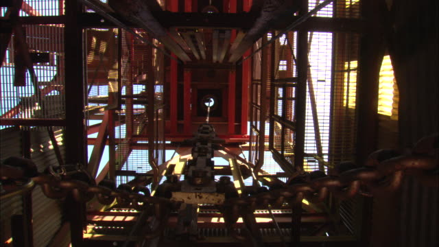 an elevator moves down a mine shaft. - mine shaft stock videos & royalty-free footage