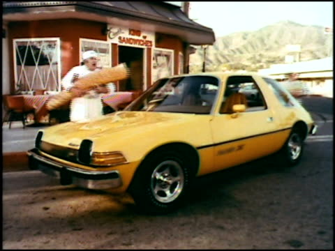 an emergency call from a wealthy customer sends the sandwich king across town in his new amc pacer the first wide small car only the pacer is wide... - fast food stock videos & royalty-free footage