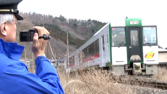 an emergency drill for a possible major earthquake in japan took train passengers to a shelter on a hill to escape tsunami the drill took place on... - drill stock videos & royalty-free footage