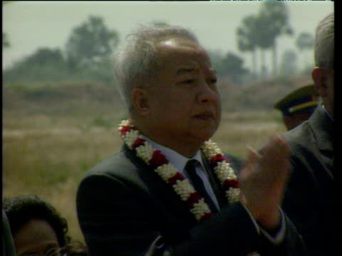 An emotional King Sihanouk lowers hands from prayer position return to Cambodia after 13 years in exile Phnom Penh 14 Nov 91