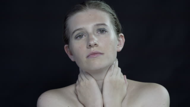 An emotional young woman crying.