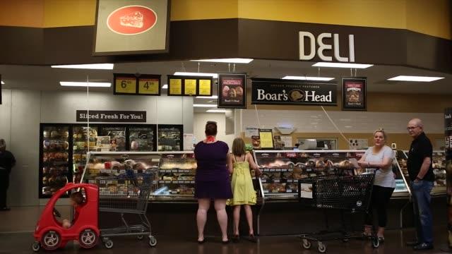 an employee arranges chiquita brands international inc bananas in the produce department inside a kroger co grocery store in louisville kentucky us... - デリカッセン点の映像素材/bロール