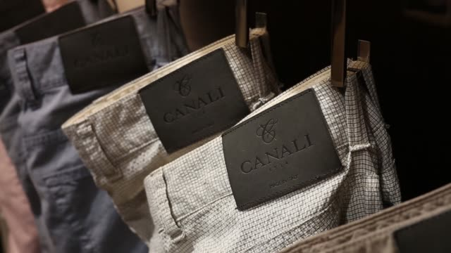 an employee attends to a customer as he tries on a suit jacket inside a canali holding spa store in hong kong the canali holding spa label adorns the... - shirt and tie stock videos & royalty-free footage