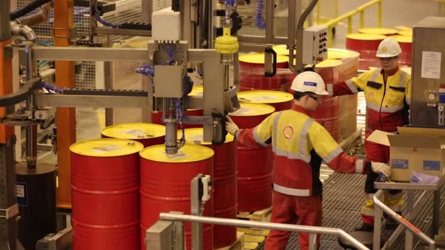 an employee caps oil drums containing lubricant oil at the royal dutch shell plc lubricants blending plant in torzhok, russia, on wednesday, feb. 7... - russia video stock e b–roll
