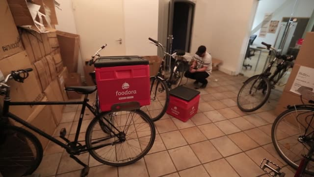 an employee carries a backpack food delivery box inside the headquarters of foodora, the food courier service operated by delivery hero holding gmbh,... - headquarters stock videos & royalty-free footage