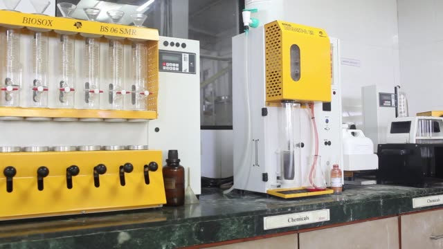 An employee carries out a protein test in a quality assurance lab at a Suhana spice factory in Pune Maharashtra India on Monday Nov 28 Employees...