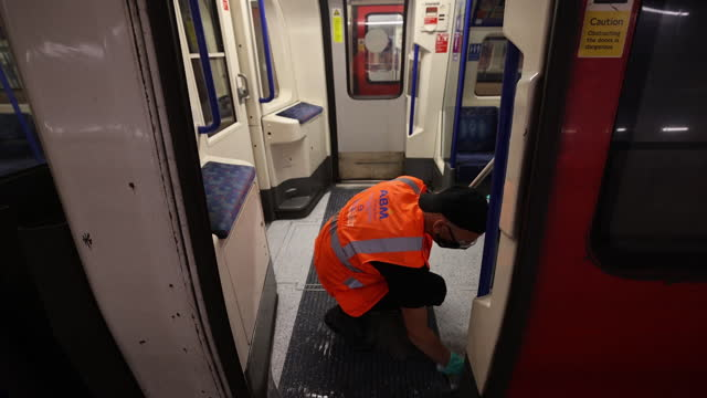 an employee cleans a london underground train interior at alstom sa depot in morden, south london, london, uk on tuesday, june 15, 2021. - vehicle interior stock videos & royalty-free footage