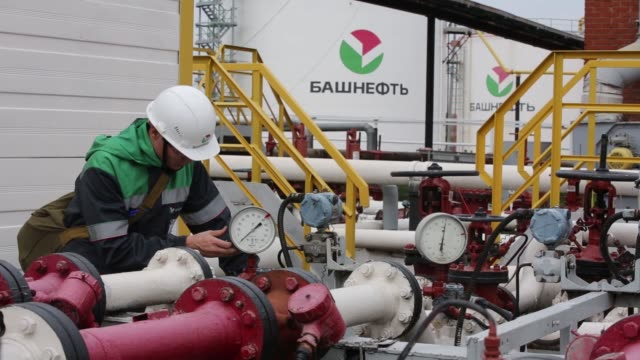 an employee climbs the access stairs to a storage tank at an oil delivery point operated by bashneft pao in sergeevka village near ufa russia on... - valve stock videos & royalty-free footage