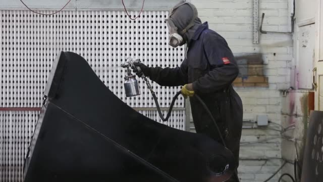 an employee cuts steel from a sheet of metal during manufacture of construction digger buckets at masterhitch ltd's manufacturing plant in strood uk... - protective sheet stock videos and b-roll footage