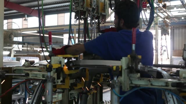 an employee drives a china faw group corp vehicle at the assembly plant of al haj faw motors pvt the local venture of faw in karachi pakistan on... - bodywork stock videos & royalty-free footage