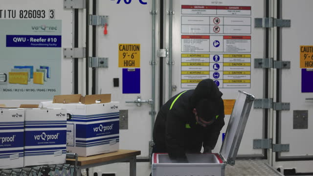 an employee fills a clinical and pharmaceutical product shipping box with dry ice at the va-q-tec ag factory in wurzburg, germany, on wednesday, nov.... - ice stock videos & royalty-free footage
