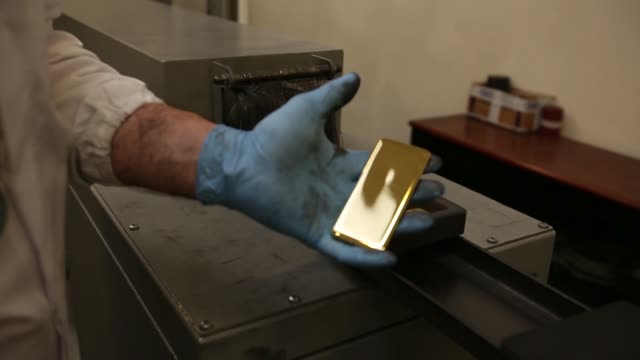 an employee fills moulds with gold to make gold ingots at the italpreziosi spa precious metals plant in arezzo, italy, on friday, july 19 an employee... - plant process stock videos & royalty-free footage