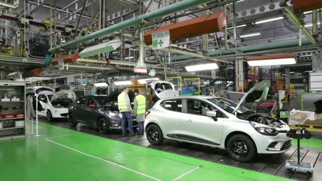 an employee fits the engine of a freshly painted nissan micra automobile inside the renault sa factory in flins, france, on thursday, feb. 23, 2017 /... - freshly painted stock videos & royalty-free footage