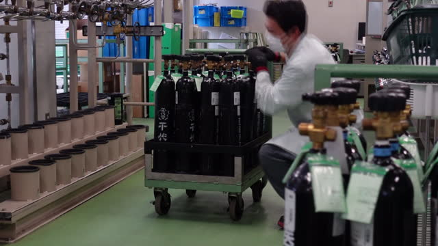 an employee in face mask checks medical gas cyliners at chiyoda ltd. factory in asaka, japan on thursday, august 26, 2021. although covid deaths have... - biochemistry stock videos & royalty-free footage