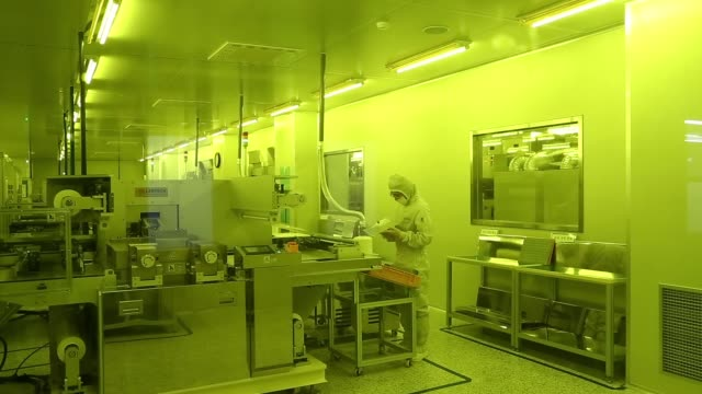 stockvideo's en b-roll-footage met an employee inspects a flexible printed circuit board panel in an exposure room at the seil electronics co factory in incheon south korea on... - incheon
