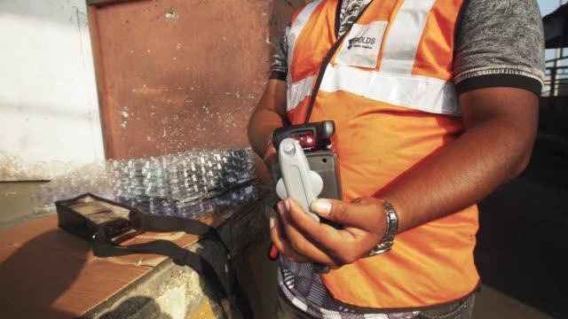 An employee inspects a transmitter device by DMICDC Logistics Data Services Ltd a joint venture between NEC Corp and DMIC Trust at the Jawaharlal...