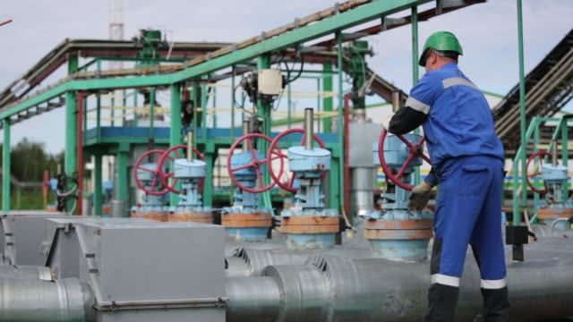 an employee inspects pressure gauges at an oil plant operated by salym petroleum in salym, khanty-mansi autonomous region, russia, on wednesday, july... - technician stock videos & royalty-free footage