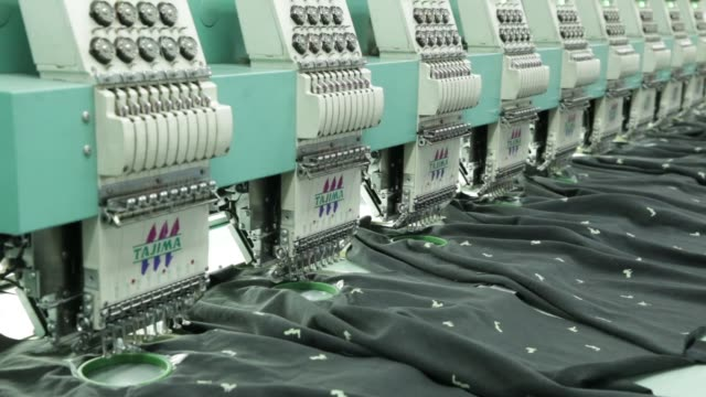 an employee inspects the output of an industrial embroidery machine at a rajlakshmi cotton mills ltd garment factory in kolkata west bengal india on... - embroidery stock videos & royalty-free footage