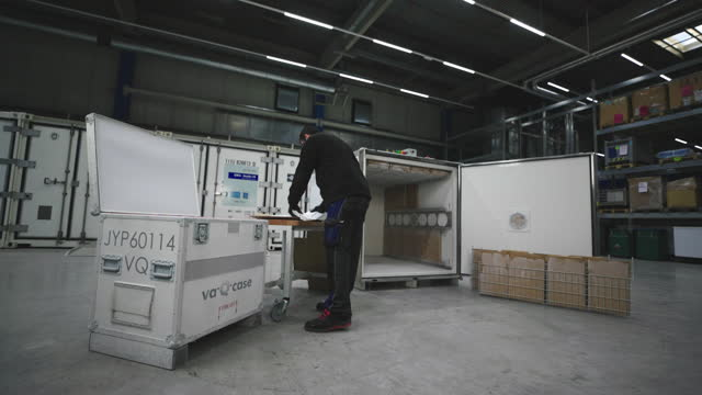 an employee loads a vac-q-case with dry ice packs at the va-q-tec ag factory in wurzburg, germany, on wednesday, nov. 18, 2020. ubs group ag said the... - ice stock videos & royalty-free footage