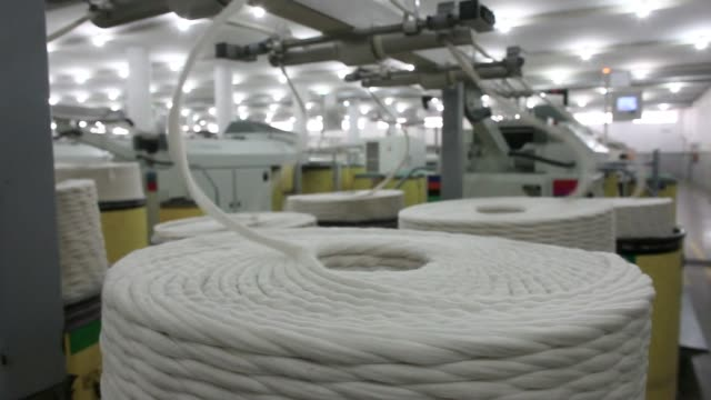 an employee monitors yarn running through drawing machinery at the artistic denim mills ltd factory in karachi pakistan on tuesday feb 6 an employee... - ball of wool stock videos & royalty-free footage