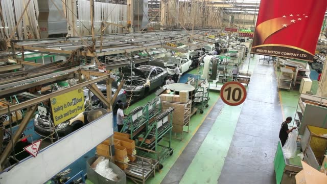 stockvideo's en b-roll-footage met an employee of indus motor co the pakistan affiliate of toyota motor corp works on the toyota corolla production line of the company's plant in... - toyota motor
