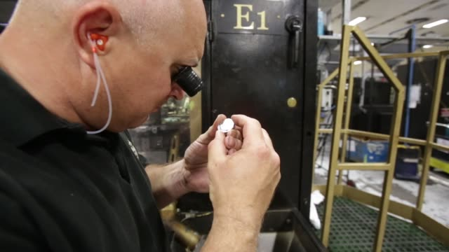 zout an employee of the royal mint inspects 20 pence coins the royal mint formed over 1100 years to produce coins for england and later great britain... - royal mint stock videos & royalty-free footage