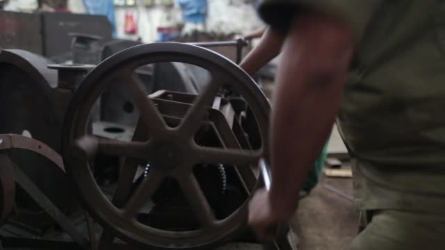 an employee operates a rolling machine an ishwar engineering co. factory in mumbai, maharashtra, india, on saturday, feb. 7, 2015 - indian subcontinent ethnicity stock videos & royalty-free footage