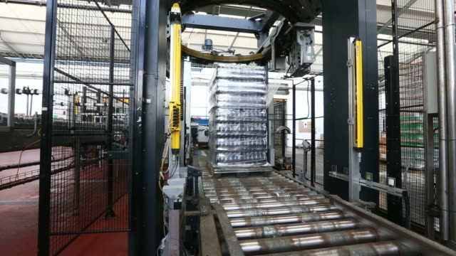 an employee operates machinery on the production line at the lanitis bros ltd bottling plant part of the coca cola hellenic group in nicosia cyprus... - キプロス ニコシア点の映像素材/bロール