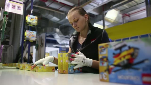 an employee packs boxes containing toys from the lego city collection at the lego a/s factory in kladno, czech republic, on monday, nov 16 a box from... - leksak bildbanksvideor och videomaterial från bakom kulisserna