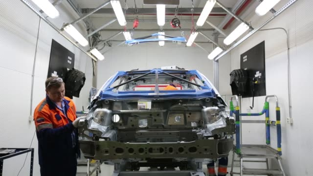 an employee performs a quality control inspection of a new ford focus automobile at the oao ford sollers assembly plant a unit of ford motor co in... - cars in a row stock videos & royalty-free footage