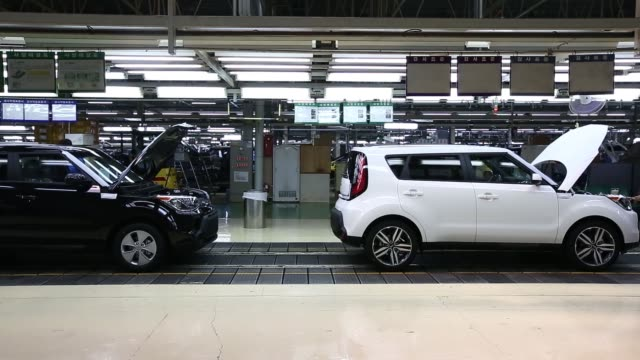 an employee performs final inspections on a kia motors corp soul vehicle on the production line at the company's plant in gwangju south korea on... - korea stock-videos und b-roll-filmmaterial
