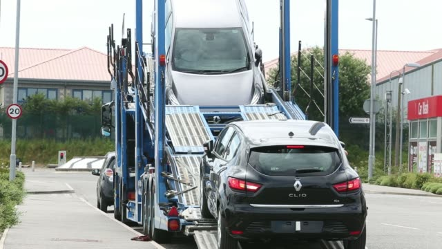an employee prepares a new renault clio automobile produced by renault sa parked on a vehicle transporter ahead of delivery to toomey motor groups... - 試運転点の映像素材/bロール