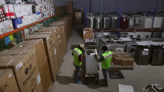 an employee repairs a washing machine in the home appliances section at the refurbishment facility of greendust a unit of reverse logistics co in new... - e waste stock videos & royalty-free footage