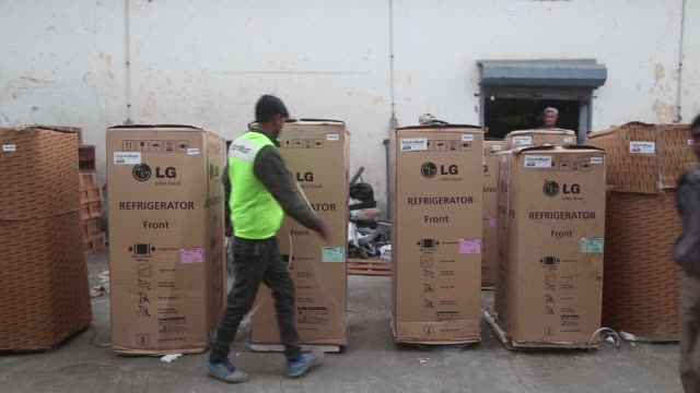 an employee secures the packaging of an lg electronics inc refrigerator outside the warehouse at the refurbishment facility of greendust a unit of... - e waste stock videos & royalty-free footage