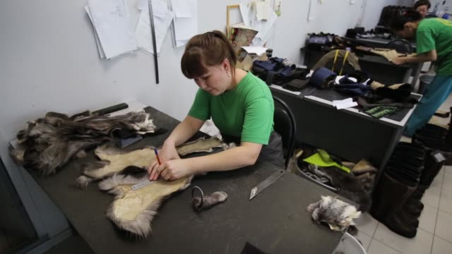 An employee selects mink furs for luxury garments at the Sardaana fur factory in Yakutsk Russia on Monday Feb 15 An employee cuts furs for luxury...