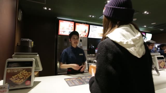 an employee serves mcchoco potato in this arranged video at a mcdonalds restaurant operated by mcdonalds holdings co japan ltd in tokyo japan on... - mcdonald's stock videos & royalty-free footage