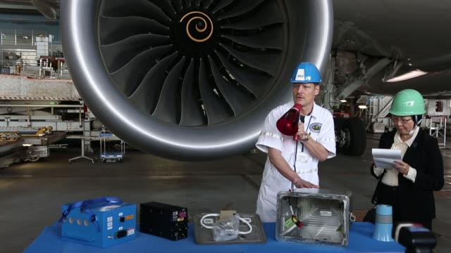 an employee speaks to the media about the newly redesigned battery for boeing co's 787 dreamliner displayed on a table in an all nippon airways co... - boeing 787 stock videos and b-roll footage