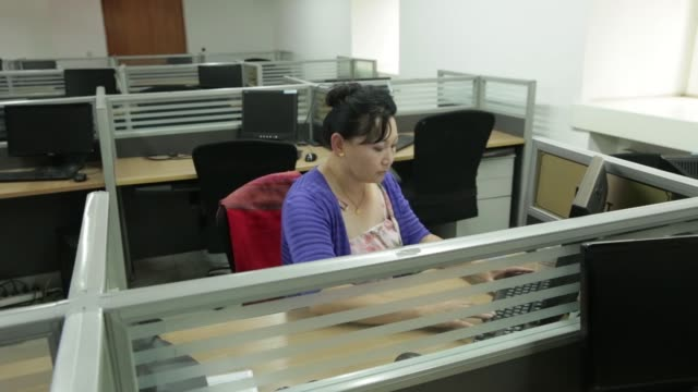 an employee talks on the phone on the trading floor of the mongolian stock exchange in ulaanbaatar mongolia on tuesday july 19 an employee works on... - quartier de la bourse stock-videos und b-roll-filmmaterial