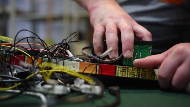 an employee tests the tests the electrical hardware of a virtual pinball machine at vpcabs in fairfield ohio on june 1 2017 shots cu of hands working... - pinball machine stock videos & royalty-free footage