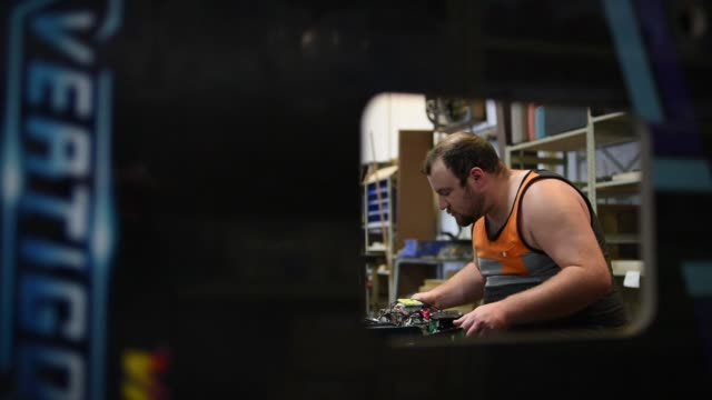 an employee tests the tests the electrical hardware of a virtual pinball machine at vpcabs in fairfield ohio on june 1 2017 shots shot of worker... - pinball machine stock videos & royalty-free footage