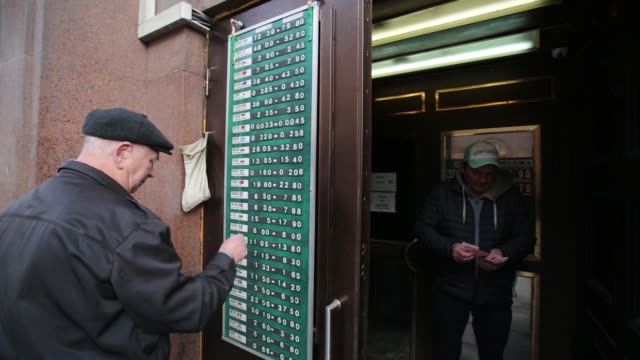 an employee updates a display of foreign exchange rates outside a currency exchange bureau in moscow russia on monday nov 10 gvs of employee changing... - chinese currency stock videos & royalty-free footage